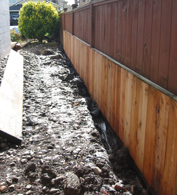 Mud and stone ... a goog reason for raised garden beds.