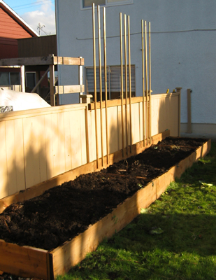 Compost has been added to this raised garden bed in the late fall.