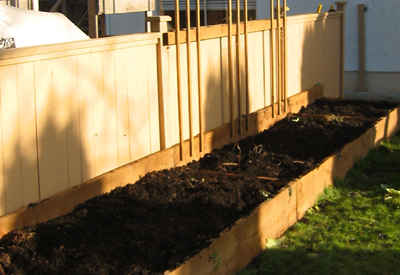 A raised bed garden that is a little too wide to work from one side